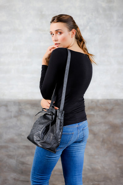 Bags and purses; black bucket bag; women's handbag; cross-body bucket bag; leather bucket bag; black leather bucket bag; crocodile leather bag; crocodile embossed leather bag;  black crocodile leather bag