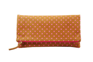 Clutch; Bags and purses; Foldover; Printed clutch; star pattern printed bag; star handbag; hot pink handbag; hot pink clutch; hot pink purse; Pink fashion accessories; print on leather bag; printed leather bags; leather foldover clutch
