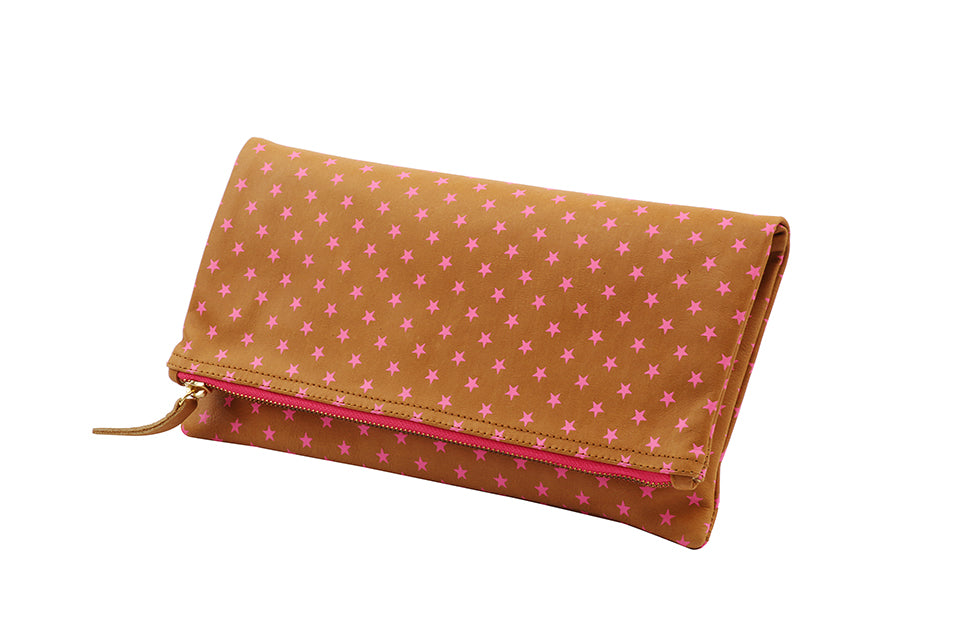 Hot pink clutch purse; hot pink fashion accessory; tan leather purse; tan leather clutch; foldover star purse; star printed bags; star printed handbags