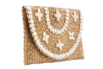 Side view brown cowrie shell tribal hand held women clutch purse