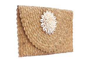 Side view cowrie shell woven clutch women handbag size 6 inches height and 12 inches wide