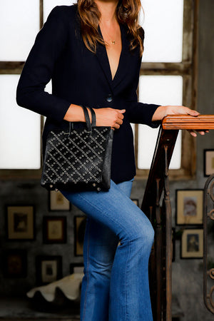 studded grommet black tote; small black cow leather tote; black tote handbag; black crossbody tote handbag; studded black crossbody handbag