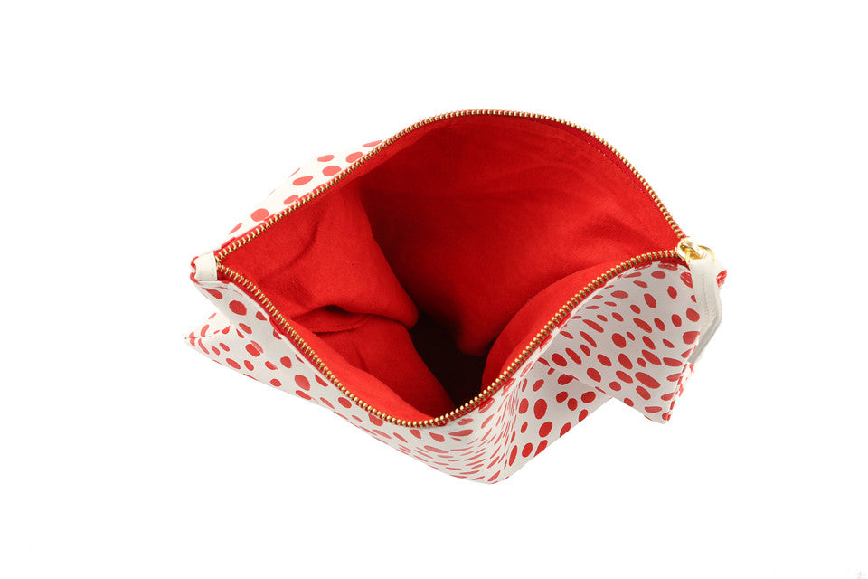 Spotted clutch; designer clutch; red spotted clutch; sophia webster; clutch; foldover clutch; foldover clutch pattern; dalmatian pattern clutch; dalmatian print clutch; leather clutch; red and white leather clutch; red and white clutch