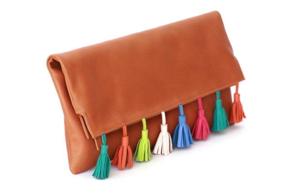 Women's Handbags; Designer handbag; Designer clutch bag; designer foldover clutch; foldover leather clutch; foldover clutch leather; foldover clutch with strap; foldover clutch tassel; tassel foldover clutch; leather tassel handbag; Tassel handbags; Sofia Tassel clutch
