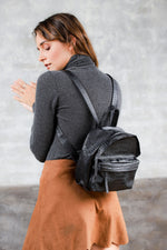 Model wearing  black leather mini backpack