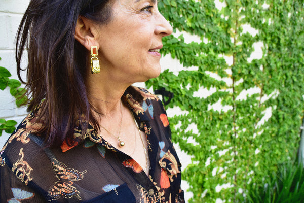 Image of Kathryn Allen wearing jewellery in her home for MM Mama Muse blog post for Mountain & Moon brand The journal