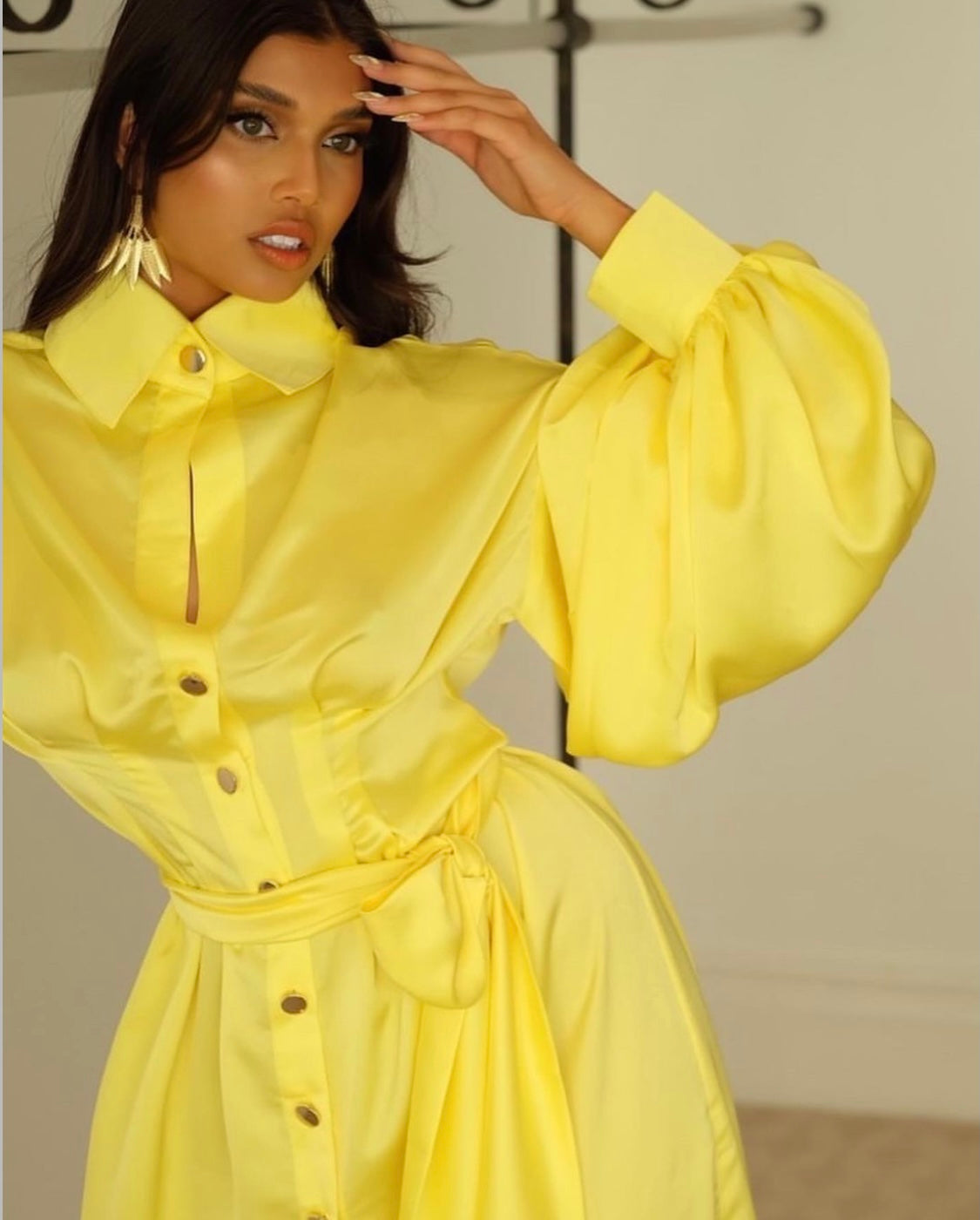 image of Shamaya shambizzle in yellow Khirzad dress and gold palm tree earrings