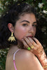 Model wearing Gold BIANCA Cocktail Ring with oval GREEN MOJAVE TURQUOISE, Gold SIGNET Ring and Ravella Palm Tree Statement Earrings by Mountain and Moon Jewellery