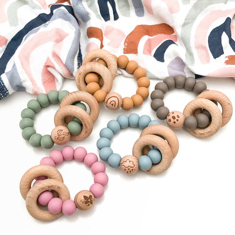 """Elements Silicone & Beech Wood Rattle Teethers"""