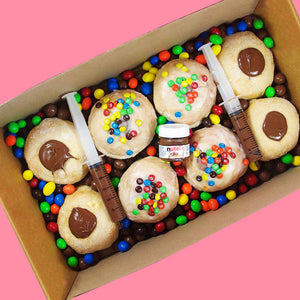 Goldeluck's Marshall Mathers doughnut box - a doughnut box with choc hazelnut filled doughnuts and glazed doughnuts with nutella and M&Ms chocolates. This doughnut box comes with Nutella syringes, a mini Nutella jar, peanut M&Ms and chocolate malt balls