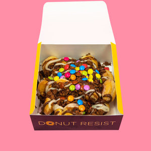 Goldeluck's Original HSP Doughnut Pack - a donut box with mini doughnut ball holes. The mini glazed donut holes are drizzled with Nutella, white chocolate, chocolate sauce and topped with M&Ms and crushed TimTam cookies.