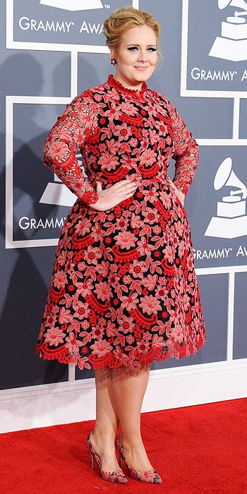 Adele steps aways from her usual black in a colorful lace frock