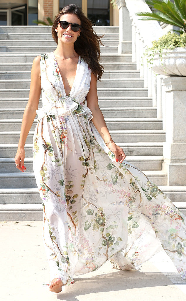 Alessandra Ambrosio in a floral print halter with plunging neckline.