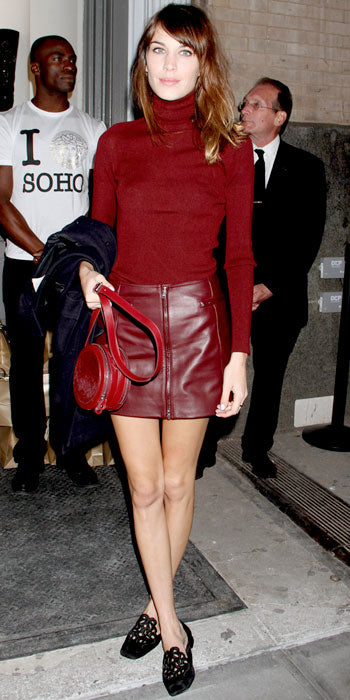 Alexa Chung spiced up her Versus turleneck with a matching leather mini at the Versace Soho store opening