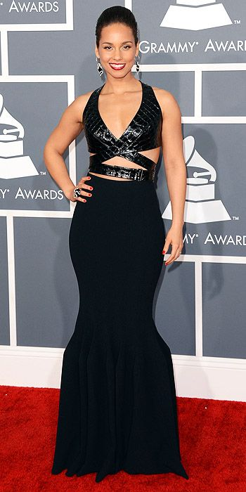 Alicia Keys is leather clad in a black gown with structured bottom