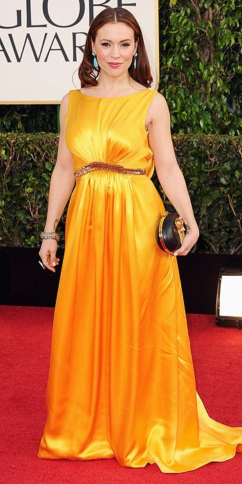 Alyssa Milano sported a gorgeous marigold color but the horrible fit of this dress doomed the whole look