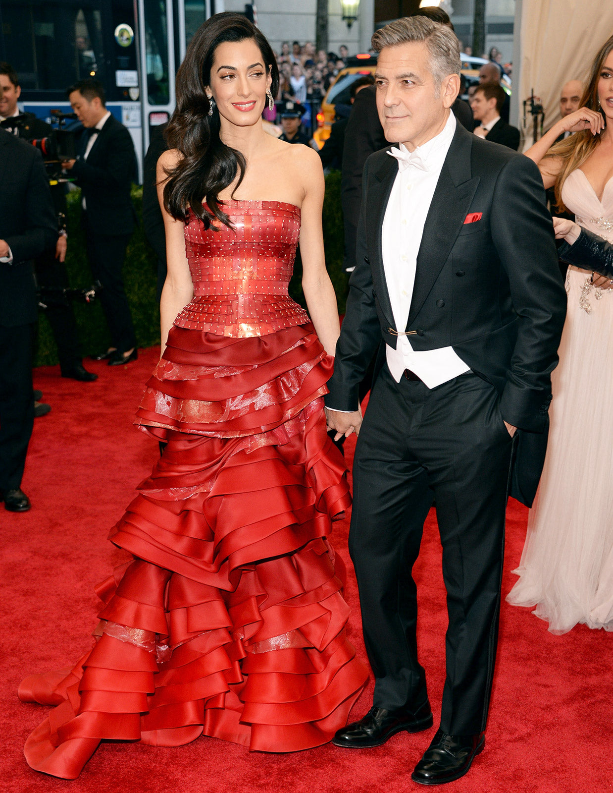 Amal Clooney in a red custom Maison Margiela Artisanal by John Galliano corset top and tiered skirt.