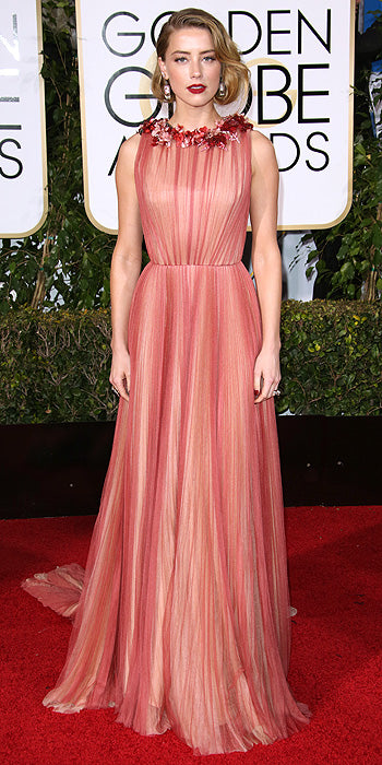 Amber Heard looked radiant in a flowing pink gown with a floral neckline. Photo by REX/Shutterstock).
