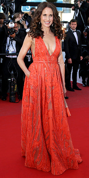 Andie Macdowell in a beaded orange gown with plunging neckline.