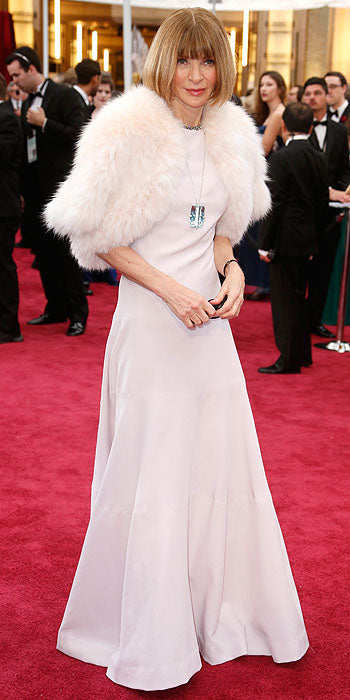 Vogue Editor-In-Chief Anna Wintour added a fur shrug to her gown.