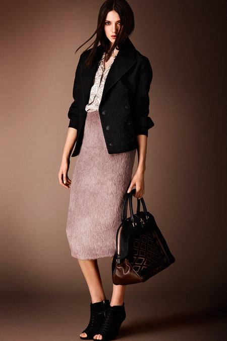 Burberry Prorsum Pre-Fall 2014. Who says you can't do pastels in the fall? This textured skirt in its unexpected hue is what makes it stand out.