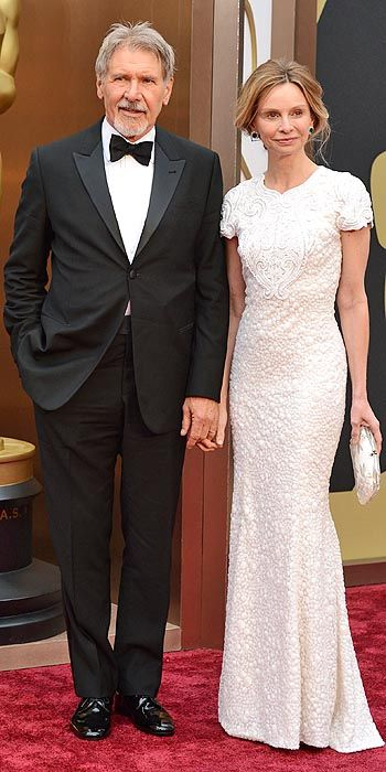 Calista Flockhart accompanied by Harrison Ford in an embroidered white gown