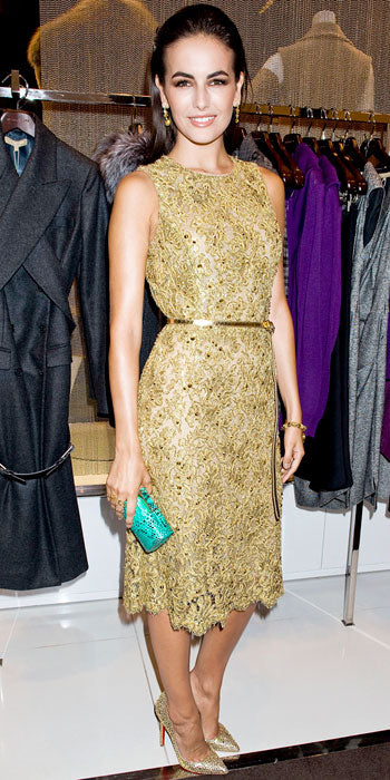 Camilla Belle fetes Michael Kors in a belted gold dress