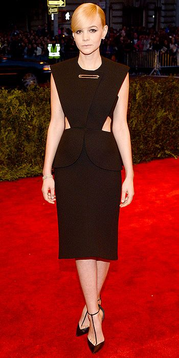 Last year's co-host Carey Mulligan kept with the dark and edgy theme in a chocolate brown cut-out dress