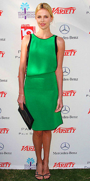 Charlize Theron is elegant in emerald green Reed Krakoff