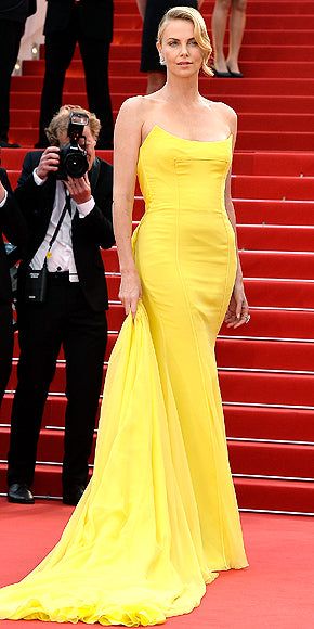 Charlize Theron looked every inch the movie star and statuesque blond in canary yellow Dior.