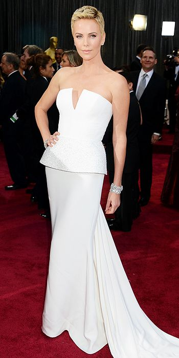 Charlize Theron looked simply stunning in a white peplum Dior gown and Harry Winston jewelry