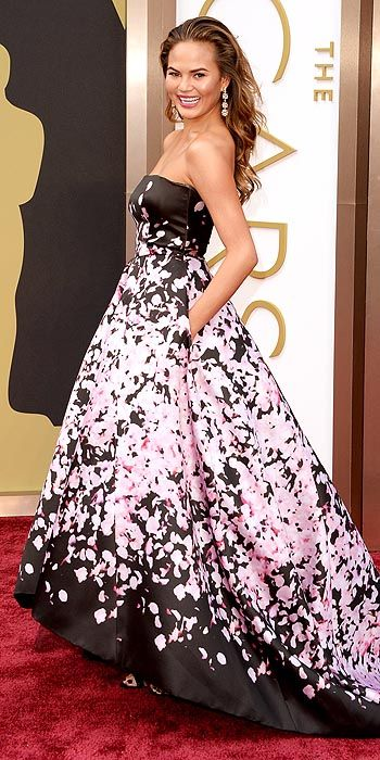 Chrissy Teigen started with black but went the direction of a full bloom in a strapless high low gown