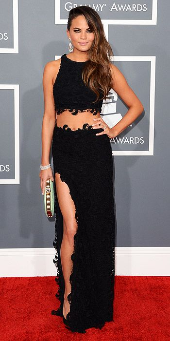 Christine Teigen showed of her taut tummy and long legs in a black dress