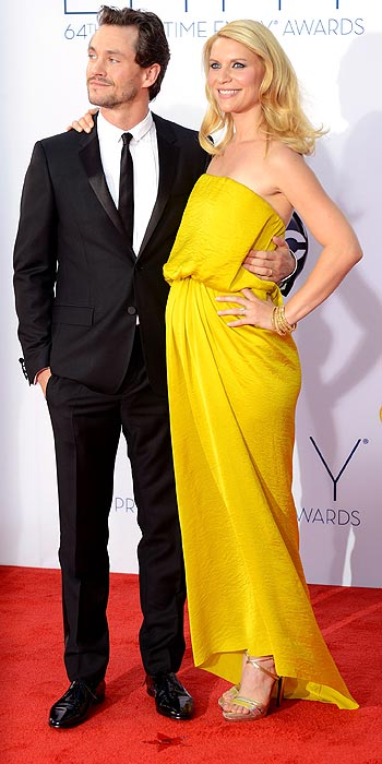 Claire Danes draped in yellow Lanvin and husband Hugh Dancy at the 2012 Emmy Awards