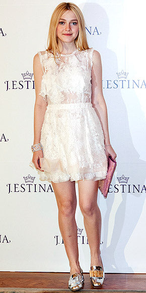 Dakota Fanning looked ethereal in white lace while attending the photocall for jewelry brand J. Estina in Seoul