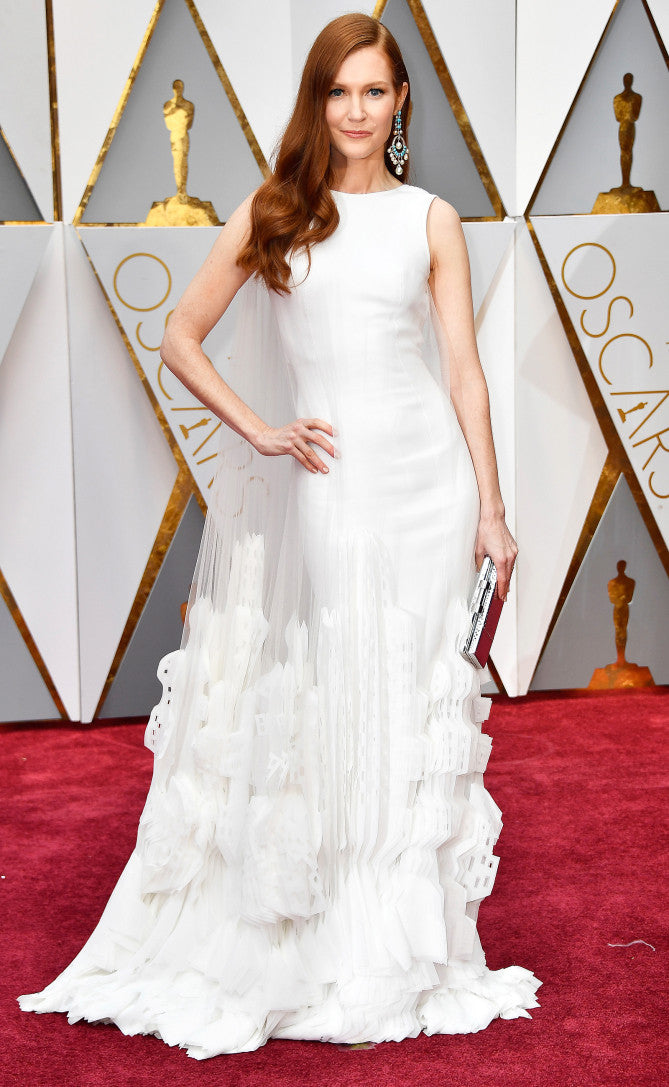 Darby Stanchfield attends the 2017 Oscars in white