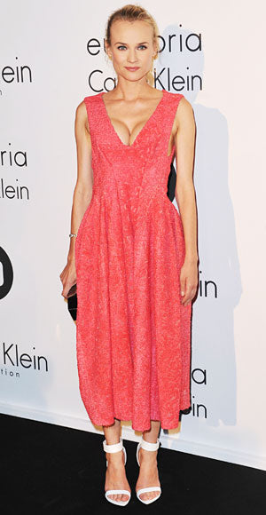 Diane Kruger attended a Calvin Klein dinner in a textured coral dress and white ankle strap Givenchy heels