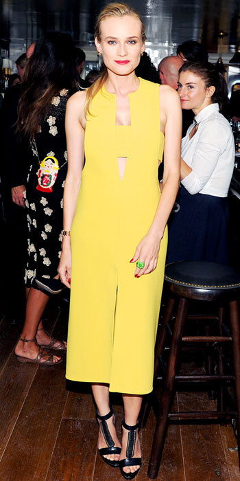 Diane Kruger attends a Calvin Klein bash in a yellow sheath from the line with cut out details