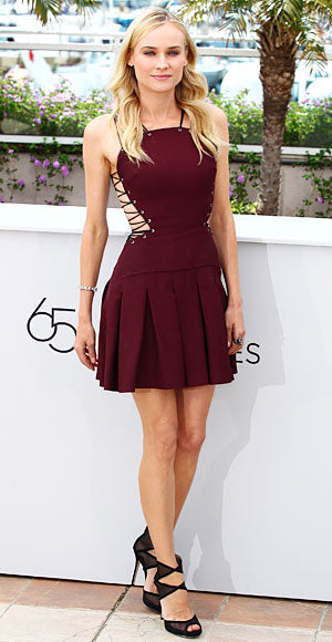 Diane Kruger kicked off the Cannes film festival in a laced burgundy Versus dress and black Jimmy Choo sandals