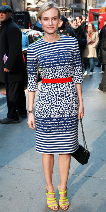 Diane Kruger mixed stripes with dots and a bold red belt