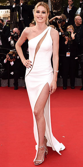 Doutzen Kroes in a white cut-out Atelier Versace gown.