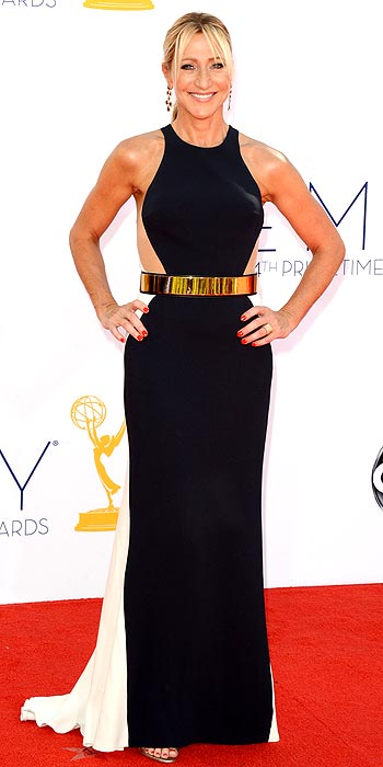 Edie Falco stunned in a black and white column gown cinched with a bold gold belt at the 2012 Emmy Awards