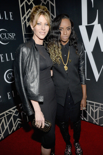 Editor-in-Chief of ELLE Robbie Myers (L) and recording artist Angel Haze.