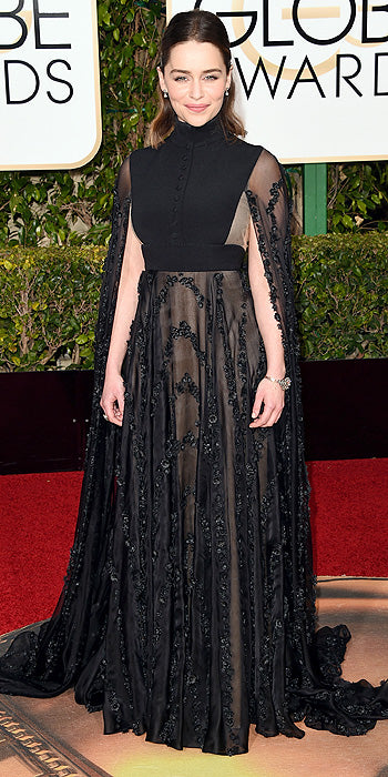 Emilia Clarke proves why she's the mother of dragons in a high neck black gown with equally dramatic cape. (Photo by Jason Merritt/Getty Images)