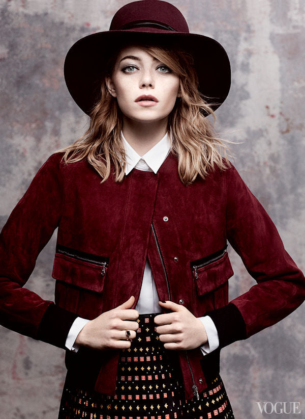 Emma Stone covers Vogue in an Erdem suede jacket and Rag and Bone Hat.