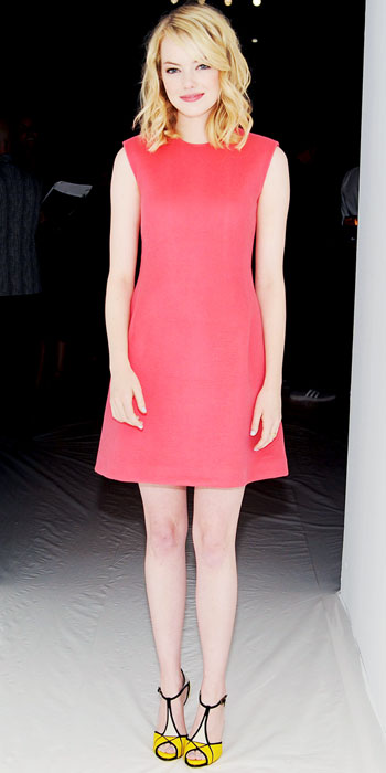 Emma Stone explores the power of color at Calvin Klein sporting a red sheath and yellow pumps with black piping