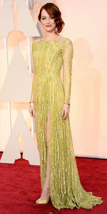 The award for the most interesting color of the night has to go to Emma Stone. This lime green Elie Saab is perfection on her skin.