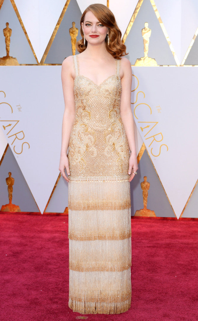 Emma Stone attends the 2107 Oscars in Fringed Givenchy