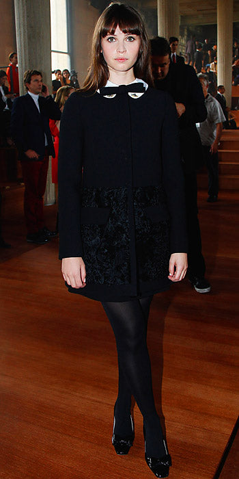 Felicity Jones attended the Miu Miu show in black