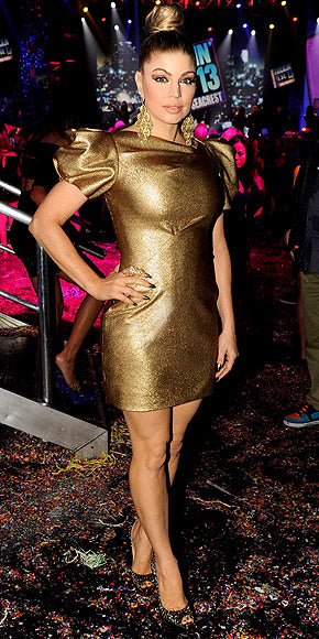 Fergie shined on New Year's Eve in a gold mini and edgy top knot